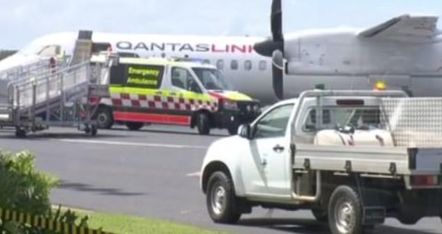 An ambulance is pictured on the runway after the flight landed. A passenger on the Qantaslink plane on Tuesday said staff and a doctor tried repeatedly to resuscitate the 85-year-old mid-flight