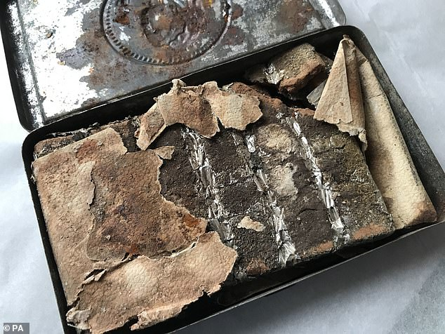 A121-year-old tin of uneaten chocolate, still in its original wrapping, which has been found in a Boer War helmet case in the attic at Oxburgh Hall in Oxborough, Norfolk