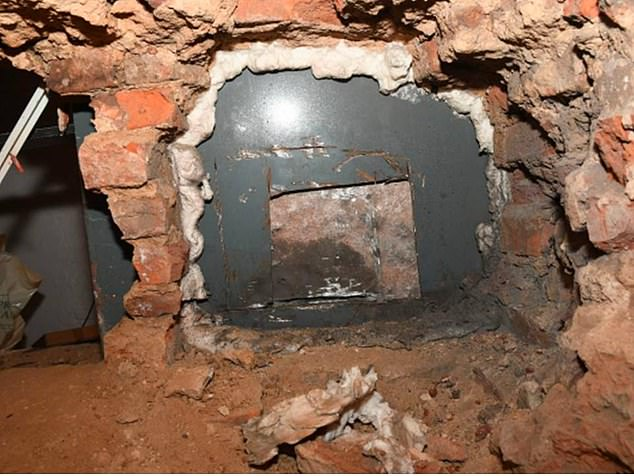 The men drilled through a dividing wall in the basement (the hole, pictured) which backed onto the safe of an antiques and jewellry shop from the rear