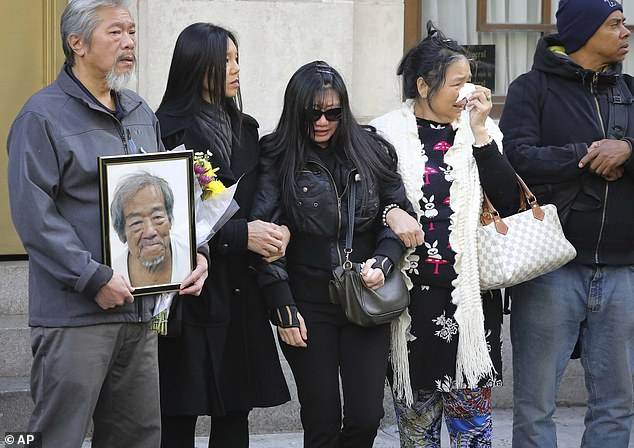 """Mourners gather after a funeral service for Chuen Kok at the Ng Fook Funeral Home on October 18, 2019, in New York City. Kok, an 83-year-old homeless man whom Chinatown residents warmly greeted as """"uncle,"""" was one of the four men bludgeoned to death in a series of crimes allegedly committed byRandy Rodriguez Santos"""