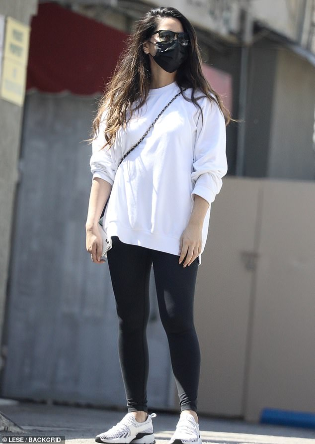 Simple style:Olivia Munn kept it simple in a black-and-white outfit Tuesday for a gym session in West Hollywood, California