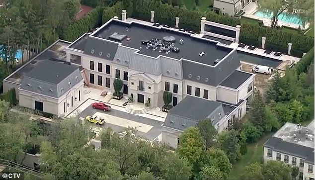 A woman allegedly armed with a knife was arrested near Canadian rapper Drake's mansion in Toronto while he was home