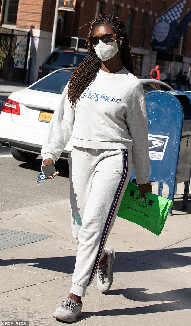Casually stylish: The actress and model, 34, looked relaxed as she strolled through the Soho neighborhood in an off-white 'Parisienne' sweatshirt and matching joggers