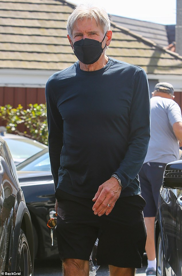 Safety first: The actor made sure to protect himself from the novel coronavirus as he sported a face mask while holding a sealed plastic bag and his shades
