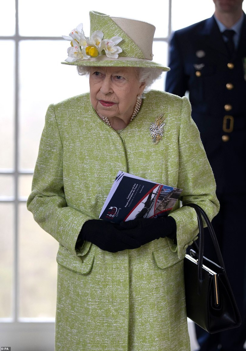 The 94-year-old clutched a programme of the day's events as she made her way around the memorial inRunnymede, Surrey