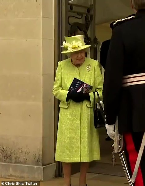 The Queen donned a pair of black gloves and clutched a programme as she watched the flypast
