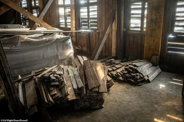 Piles of wood are pictured laid out on the floor of the former camp. After the camp was liberated, it became a social space for workers of the National Tobacco Monopoly before being passed to the National Grain Facilities, which used it to store grain. It began to fall into disrepair in the 1980s when it was owned by the National Treasury