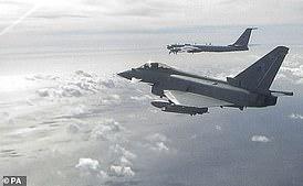 An RAF Typhoon intercepting a Russian 'Bear' bomber off the Scottish coast last September