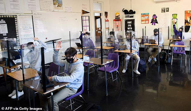School-acquired coronavirus infections made up 3.15% of all cases in the first scenario, 4.19% in the second and 2.37% in the third. Picturde:Students attend an in-person English class at St Anthony Catholic High School in Long Beach, California, March 24