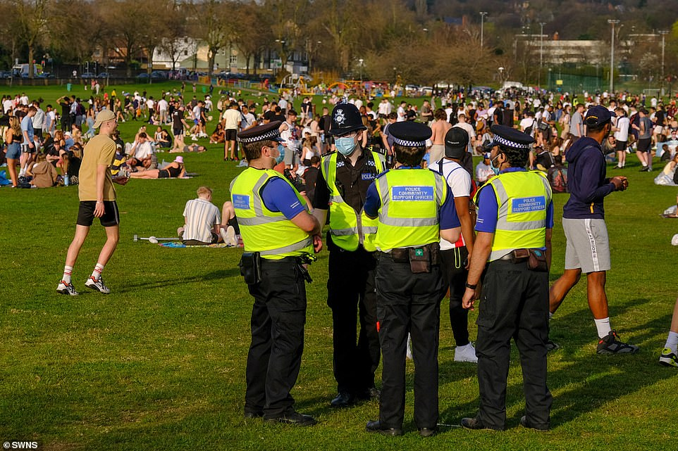 Crowds gatheredat the Forest Recreation Ground in Nottingham in the warm weather yesterday. Police were seen ensuring people were following social distancing rules