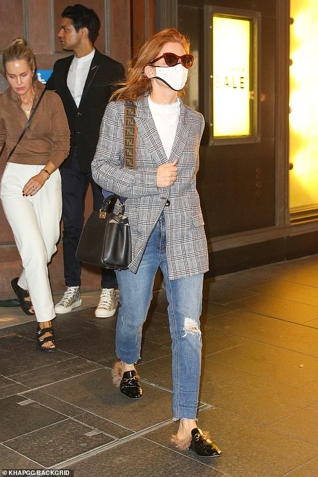 Stylish:Isla, 45, dressed to impress in blue jeans and a high-neck white shirt