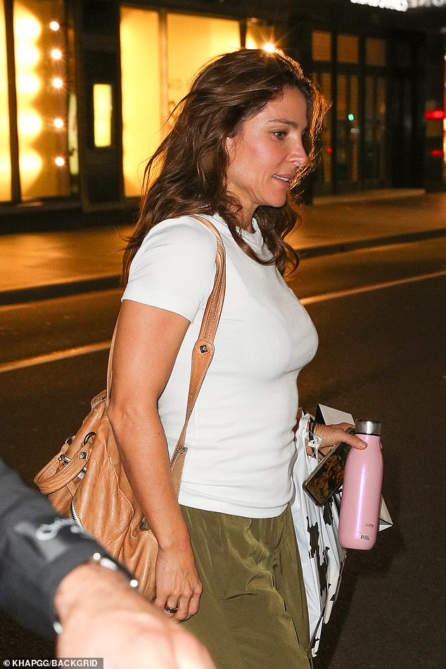 Laid-back: The Spanish actress, 44, who is married to Thor star Chris Hemsworth, accessorised with a pair of black and green sneakers and a brown backpack