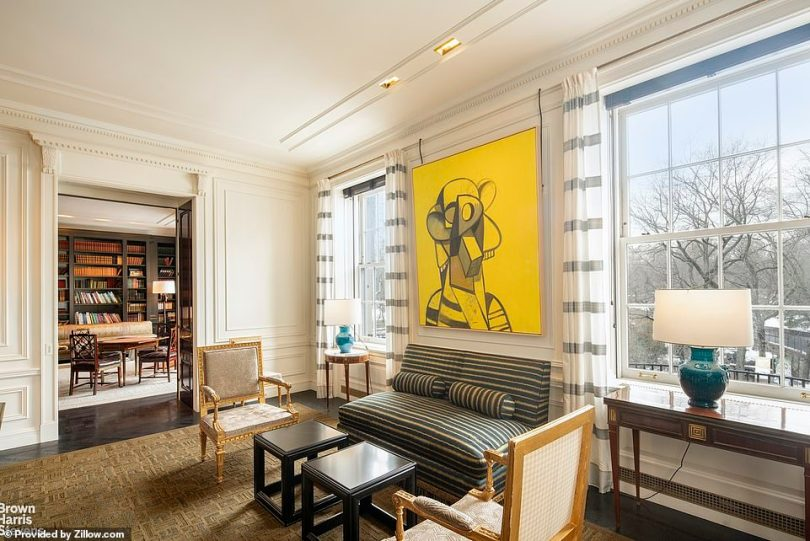 The apartment overlooks a tree-lined street along Central Park and includes Juliet balconies and French doors
