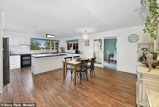 Updated: The combined area then flows to a spacious kitchen that is fitted with top of the range appliances, an island table and sleek cabinetry.