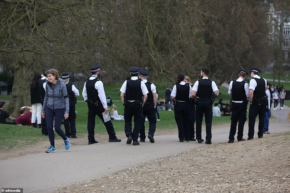Police were seen in Primrose Hill yesterday as Britons rushed to the great outdoors. The weather has been unseasonably sunny this week