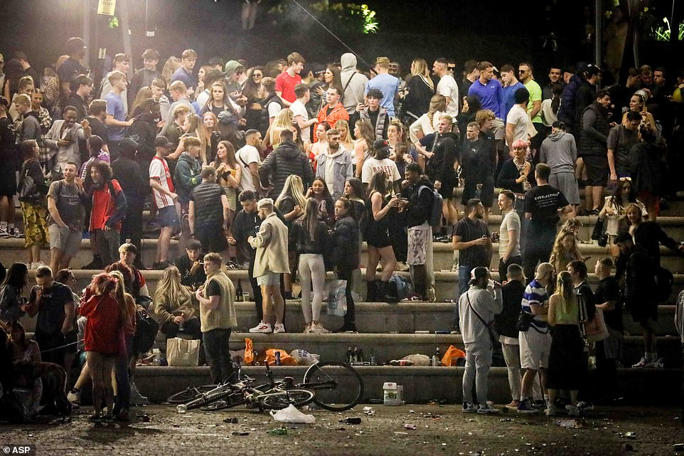 The rave at Castlefield Bowl in Manchester before it was cleared by police last night. Hundreds of people had gathered at the city centre location