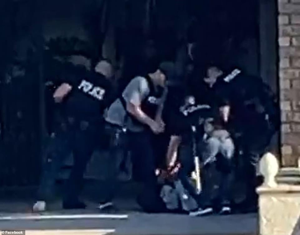 Police arrest a suspect in footage purporting to show the moment the gunman was detained by cops after the bloody massacre