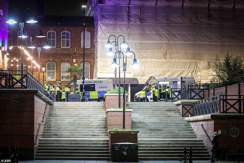 Police officers are seen arriving at the CastlefieldBowl in Manchester City Centre last night as hundreds partied