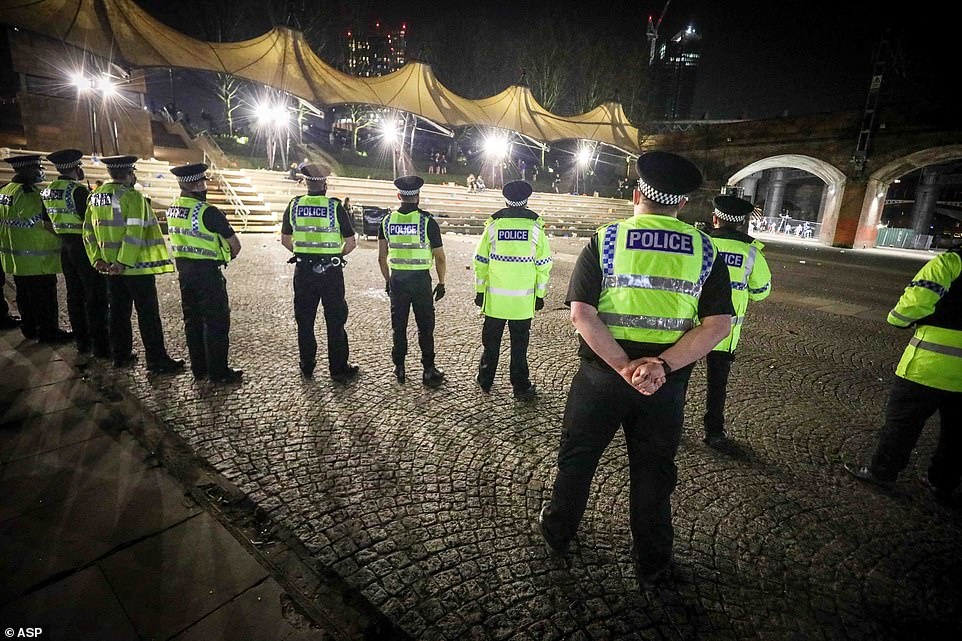 Police officers standing in the Castlefield Bowl area inManchester City Centre last night after a massive rave