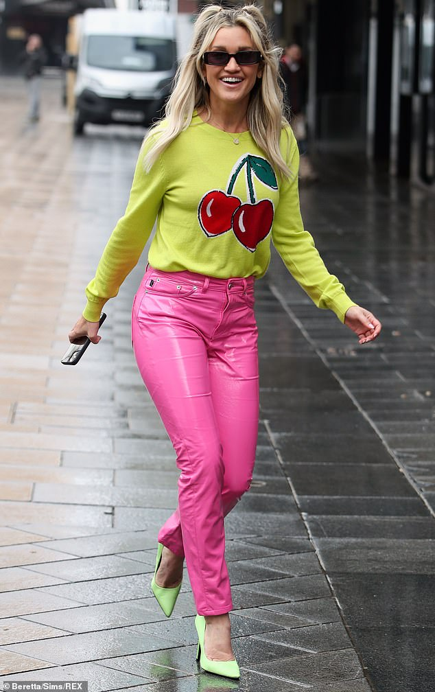 Striking: The former Pussycat Dolls star, 39, provided a pop of colour with her vibrant ensemble as she strutted inside theLeicester Square building ahead of her Heart FM show