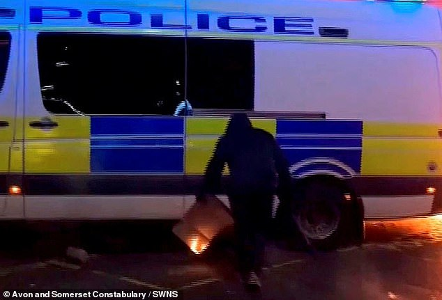 A video grab of a man trying to set the van on fire outside Bridewell police station during the riots on March 21