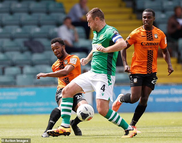 Collins in action as Yeovil's captain against Barnet in last season's National League play-offs