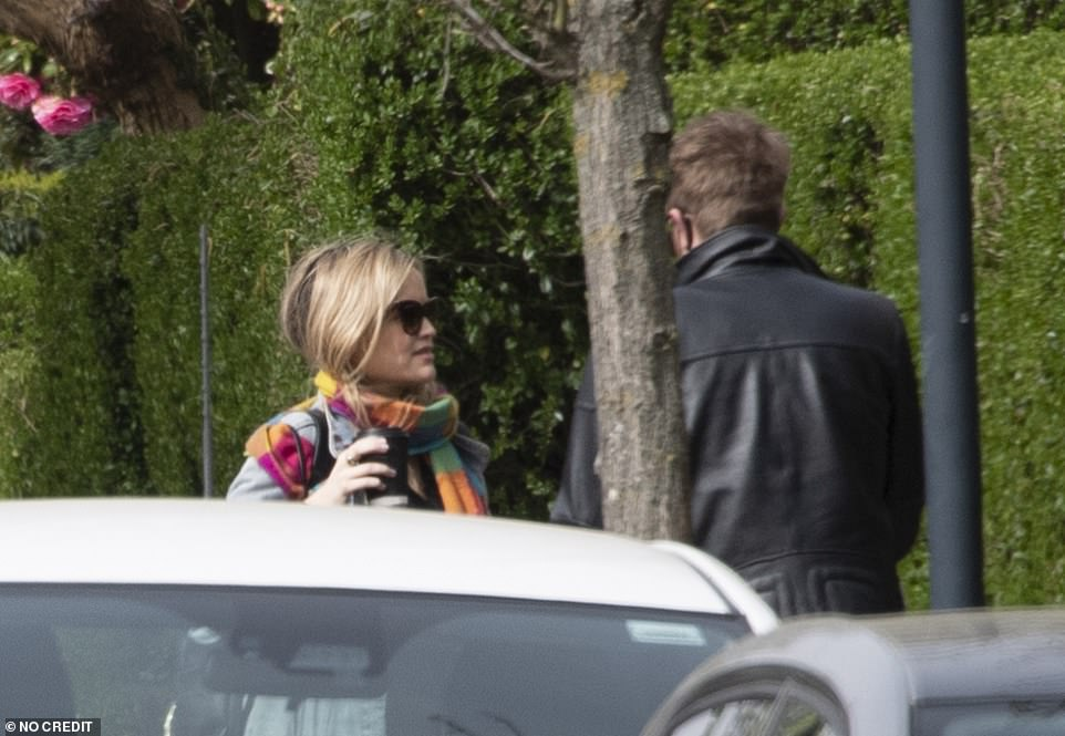 Conversational: The couple chatted to one another after getting out of the car as they made the most of the heatwave
