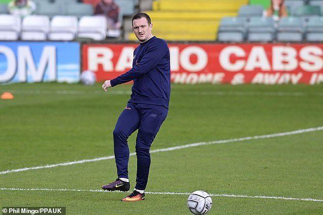 Collins is pictured warming up ahead of Yeovil's National League game against Barnet last weekend