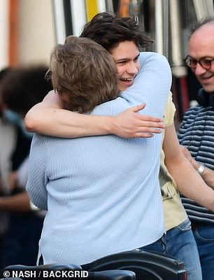 Sweet: He was later seen hugging someone on set