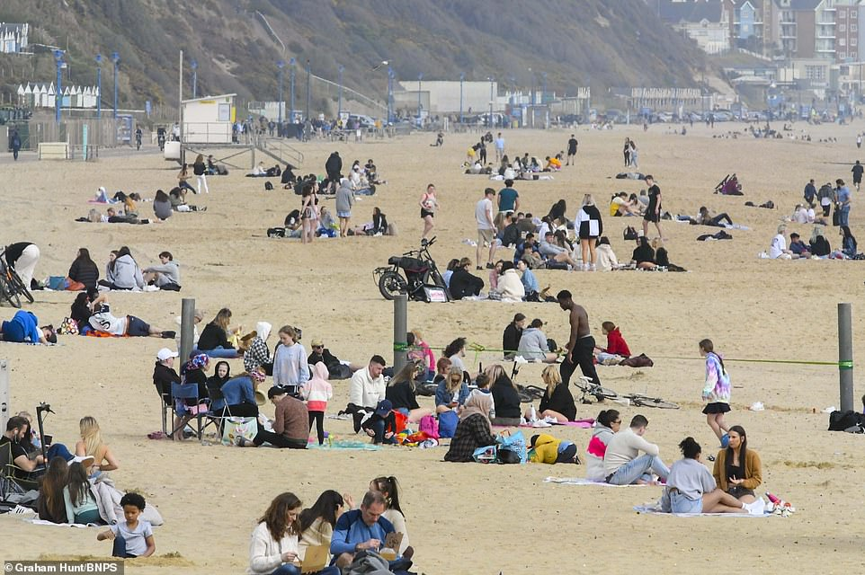 Groups stuck to the Rule of Six at Bournemouth beach today. Temperatures int he south east and London are expected to fall to around 12C on Saturday
