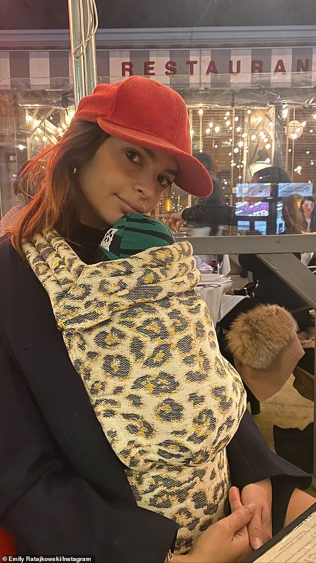 Mom mode: Emily Ratajkowski basked in the joys of motherhood as she cradled her baby boy while out in New York on Wednesday evening