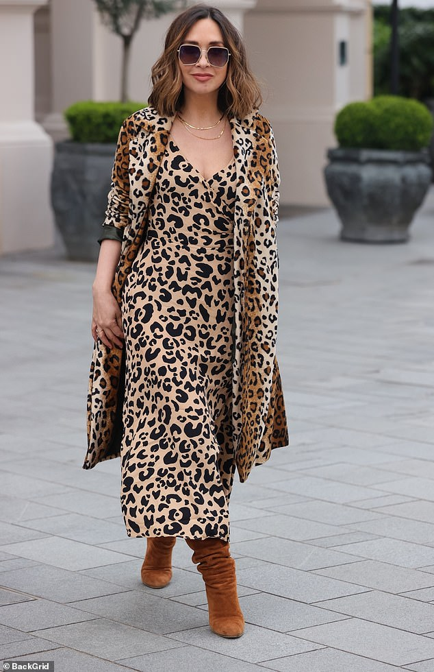 Wow! Myleene Klass took a walk on the wild side on Thursday as she sported a stylish animal print dress and matching coat as she arrived at work to present her Smooth Radio show