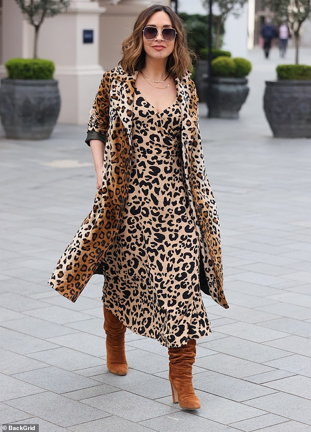Accessorising tastefully: Myleene boosted her height with chestnut suede boots while adding a touch of glamour with gold necklaces