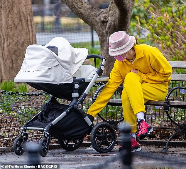 Breather: The busy model was seen taking in a quiet afternoon with her bundle of joy