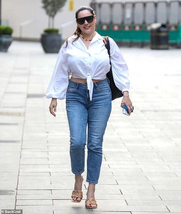 Looking good!Kelly Brook, 41, was clearly embracing the sunny spring weather as she strutted into work at Heart FM on Thursday