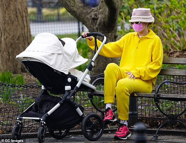 Bright:Despite her best attempts to go incognito, the striking blonde beauty was hard to miss in her outfit