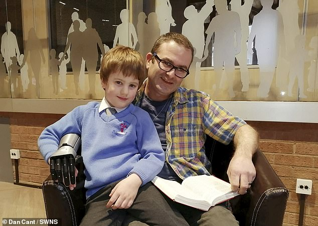 His son Aaron, 7, dubbed his father 'a real-life hero' and searched online for bionic arms when he found the firm