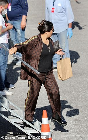 Chilled: She seemed relaxed as she strolled around the set in her eye-catching ensemble