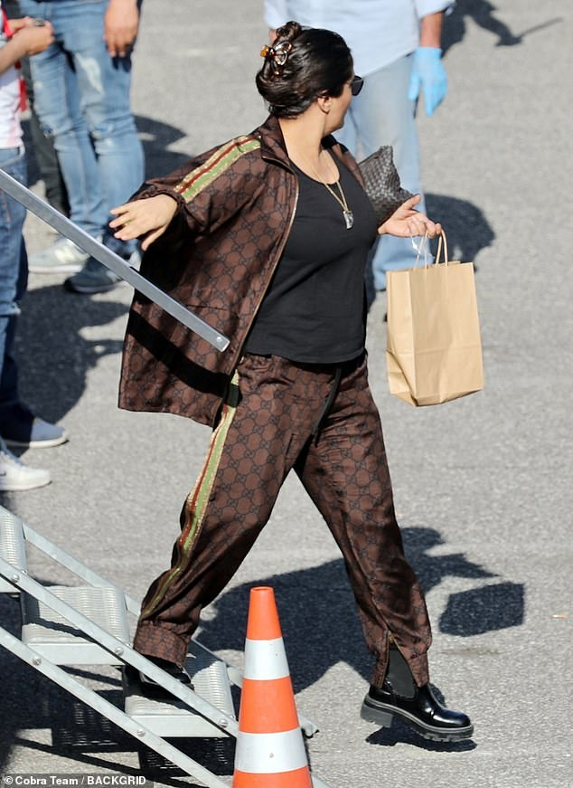 Here she is: Salma Hayek donned a brown Gucci tracksuit as she was seen for the first time on the set of new film House Of Gucci on Thursday