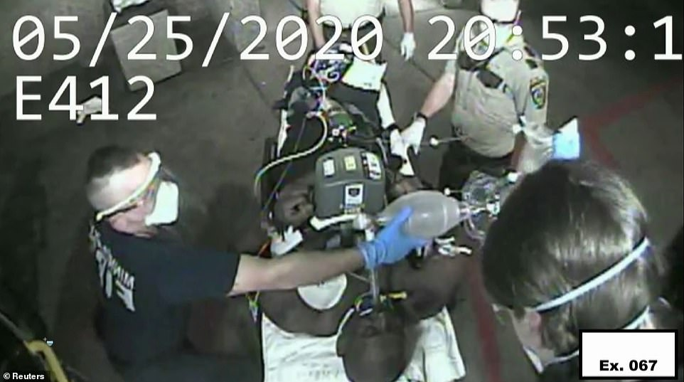 Video then showed paramedics removing Floyd from the ambulance at a hospital, where he was pronounced dead