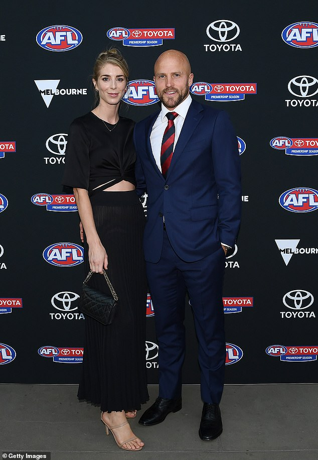 Their story: Jerri and Nathan have been together since high school and married in 2012. The couple are pictured together at the 2020 AFL season launch in March