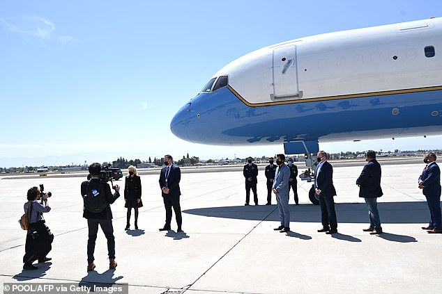 Biden poses for photos with volunteers before departing from Meadows Field Airport in Bakersfield, California, on Thursday