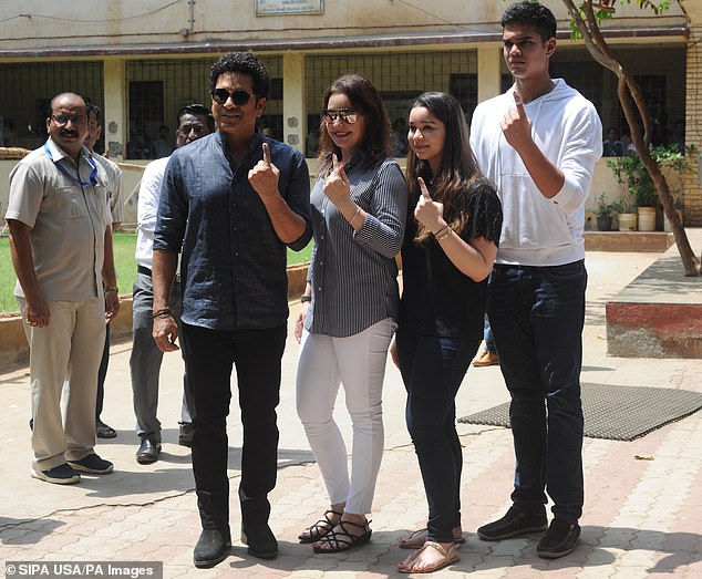 Tendulkar pictured with (L to R) wife Anjali, daughter Sara and son Arjun in 2019 in Mumbai