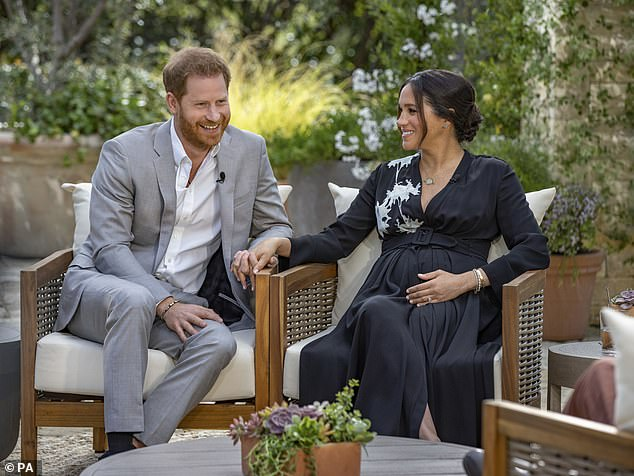 Princess Diana 's biographer claimed that Meghan Markle appeared to lead a 'normal life' during her time as a royal - despite the bombshell revelations she made during the tell-all Oprah Winfrey interview. Pictured,the Duke and Duchess of Sussex during their interview with Oprah Winfrey which was broadcast in the US on March 7