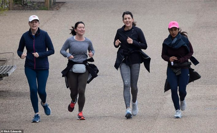 People out jogging on London's Bankside near the Tate Modern this morning, with mild temperatures forecast for today