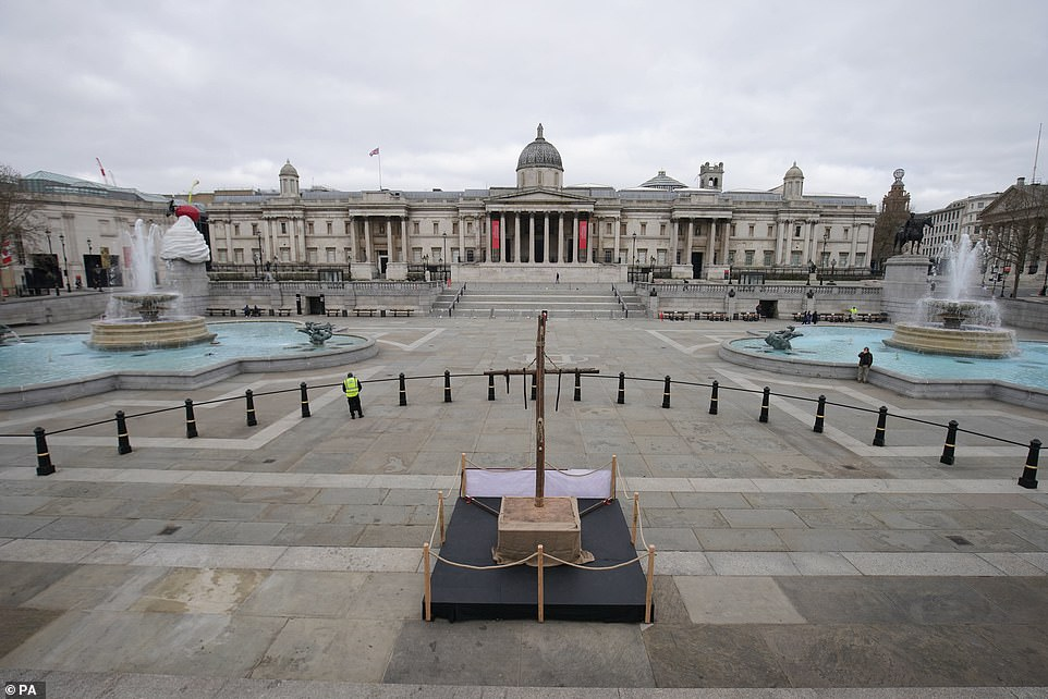 BRITAIN: A crucifix placed in Trafalgar Square, in locked-down London, on Good Friday, for the Christian holiday commemorating the crucifixion of Jesus and his death at Calvary