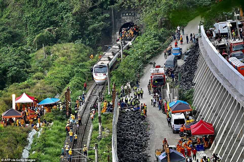 This photo shows rescue workers at the site where a train derailed inside a tunnel in the mountains of Hualien