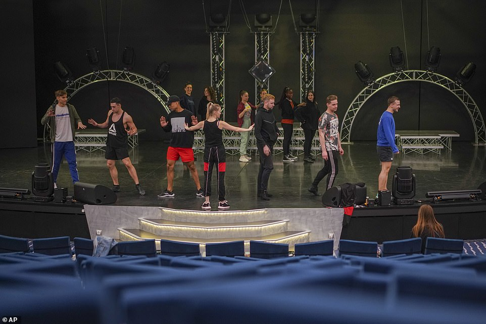 The Grandiosa's theatre has remained open for performances for passengers during the pandemic (pictured, actors and dancers practice for a show)