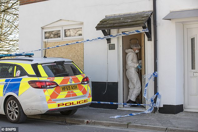 Neighbours today described seeing armed police smashing down the door of the Portland property before finding the body inside. Police are seen searching the house today
