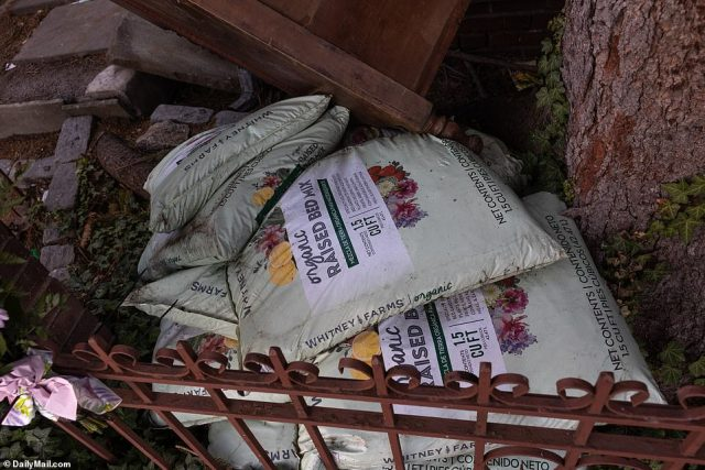 Bags of potting soil are seen stacked up outside Sakash's home. She reportedly fell into a depression following the death of her mom last year